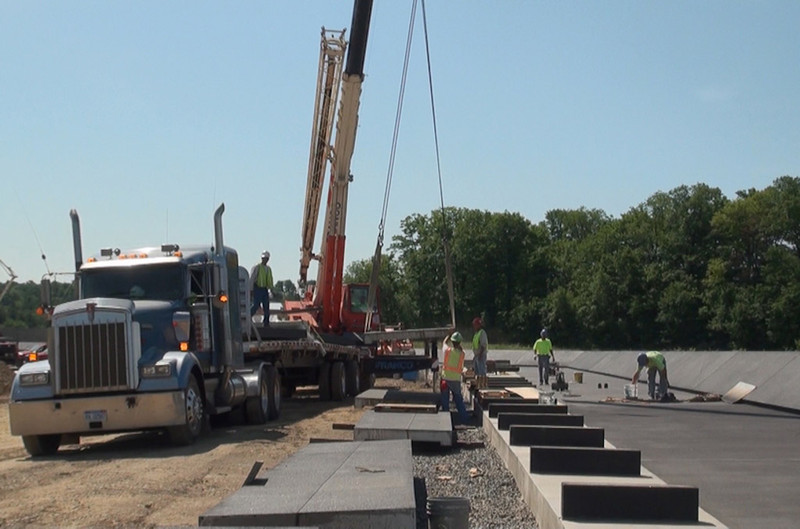 June 2011: Installing benches along the Memorial Plaza walkway (Image credit:  Richard Snodgrass)