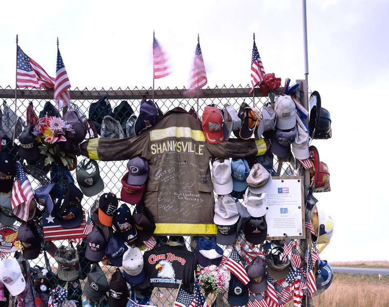 The Flight 93 Memorial soon after the 9/11 plane crash in Shanksville, Pennsylvania.  The jacket with the words Shanksville on it is an original coat from one of the firemen that arrived on the scene when the plane crashed into the field.[@ Carol M. Highsmith]