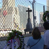 New York, NY, September 12, 2002 -- People from all over the world stop to remember and place memorials along the fence surrounding Ground Zero.<br /> <br /> Photo by Lauren Hobart/FEMA News Photo