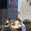 New York, NY, September 12, 2002 -- A group of people  stop along the fence surrounding Ground Zero to remember those who lost their lives last September 11th. <br /> <br /> Photo by Lauren Hobart/FEMA News Photo