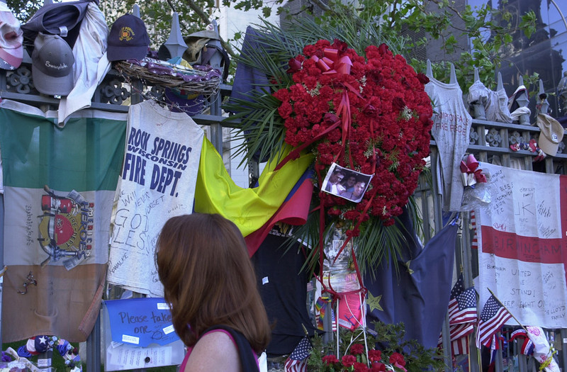 New York, NY, September 12, 2002 -- People from all over the world stop to look and place memorials along the fence of St Paul's Church near Ground Zero.<br /> <br /> Photo by Lauren Hobart/FEMA News Photo