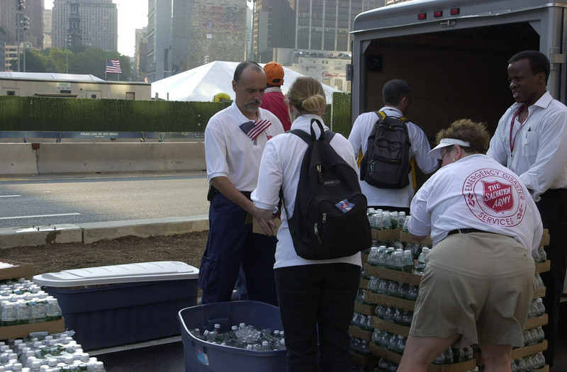 New York, NY, September 11, 2002 --The Salvation Army hands out bottled water to the thousands who have come to Ground Zero to honor the victims lost a year ago at the World Trade Center site.<br /> <br /> Photo by Lauren Hobart/FEMA News Photo