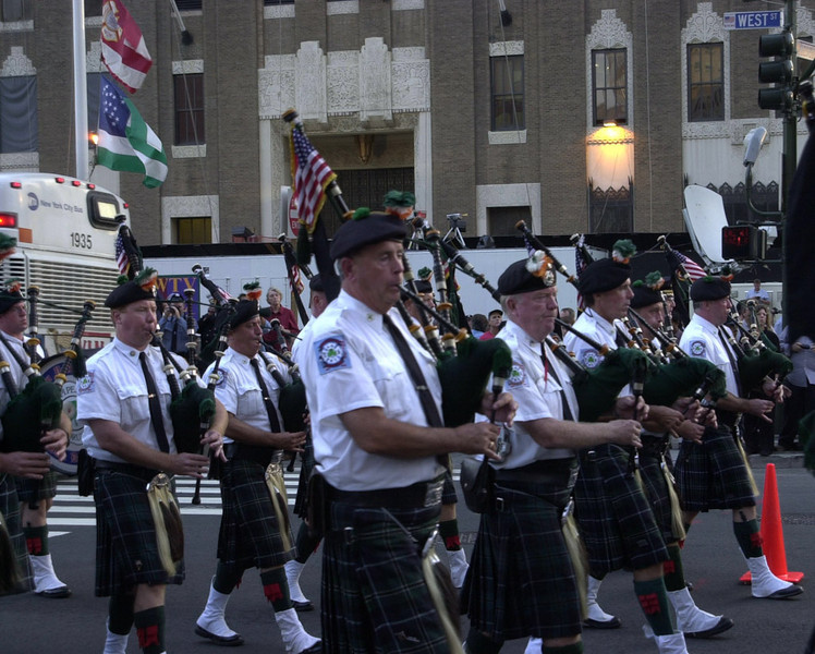 New York, NY, September 11, 2002 -- Bagpipers march toward Ground Zero to honor the victims lost a year ago at the World Trade Center site.<br /> <br /> Photo by Lauren Hobart/FEMA News Photo