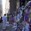 New York, NY, September 12, 2002 -- New Yorkers and tourists from all over the United States and other countries stop to look at the memorials that are placed along the fence of St Paul's Church near Ground Zero.<br /> <br /> Photo by Lauren Hobart/FEMA News Photo