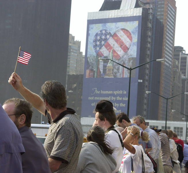 New York, NY, September 11, 2002 -- People from all over the world have come to Ground Zero to honor the victims lost a year ago at the World Trade Center site.<br /> <br /> Photo by Lauren Hobart/FEMA News Photo
