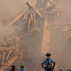 New York City, NY, September 13, 2001 -- <br /> Firefighters continue to battle smouldering fires amidst the wreckage of the World Trade Center.<br /> <br /> Photo by Andrea Booher/ FEMA News Photo
