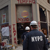 World Trade Center, New York September 13, 2001  NYPD enter their temporary headquarters near the World Trade Center. Andrea Booher/FEMA photo