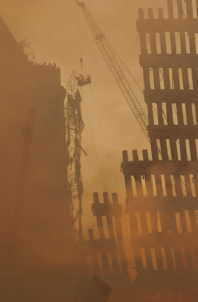 New York City, NY, September 13, 2001 -- <br /> Workers use a crane to clear debris from buildings surrounding the wreckage of the World Trade Center.<br /> <br /> Photo by Andrea Booher/ FEMA Photo News