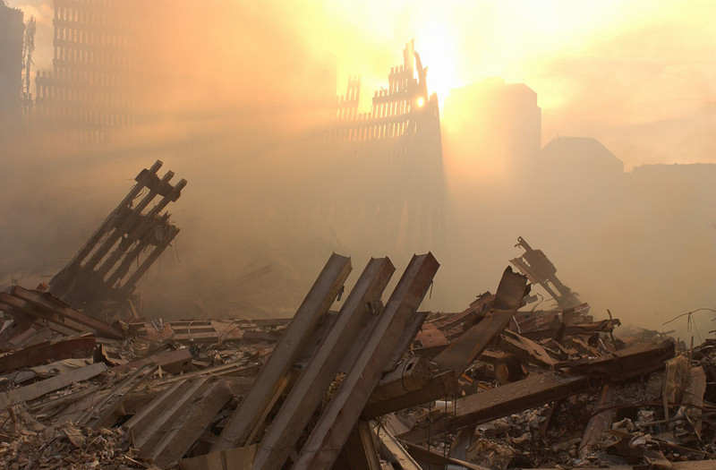 New York, NY, September 13, 2001 -- The sun streams through the dust cloud over the wreckage of the World Trade Center.<br /> <br /> Photo by Andrea Booher/ FEMA Photo News