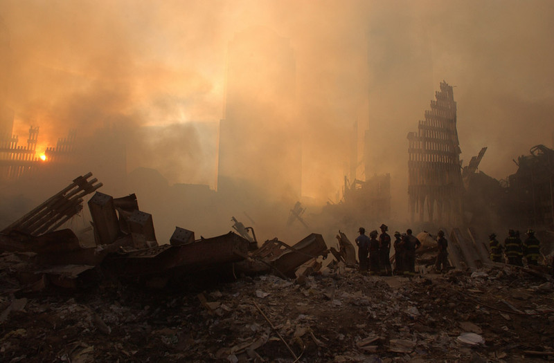 New York, NY, September 13, 2001 -- The sun streams through the dust cloud over the wreckage of the World Trade Center.<br /> <br /> Photo by Andrea Booher/ FEMA News Photo