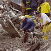 New York, NY, September 20, 2001 -- Rescue workers use a torch to cut a large piece  of debris so that it can be removed without disturbing layers below.<br /> <br /> Photo by Mike Rieger/ FEMA News Photo