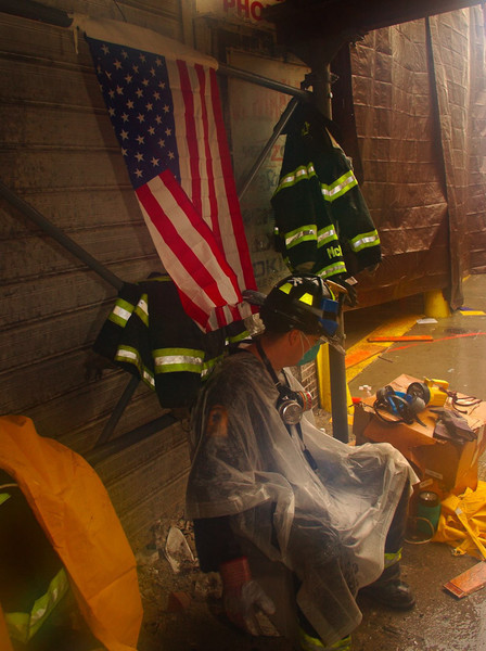 New York, NY, September 20, 2001 -- A New York City firefighter rests after clearing rubble from the World Trade Center. The clean up operation is expected to take months.<br /> <br /> Photo by Andrea Booher/ FEMA News Photo
