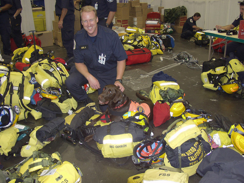 New York, NY, September 20, 2001 -- A rescue worker from a Santa Barbara, California Urban Search and Rescue team, and his dog,  pause while preparing to return to the World Trade Center crash site.<br /> <br /> Photo by Mike Rieger/ FEMA News Photo