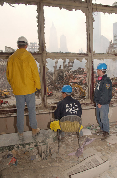 New York, NY, September 20, 2001 -- NYPD look at the wreckage of the World Trade Center from adjoining building.<br /> <br /> Photo by Andrea Booher/ FEMA News Photo