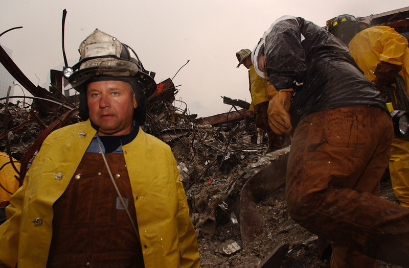New York, NY, September 20, 2001 -- Firefighters continue to battle smouldering fires and search for survivors amongst the wreckage of the World Trade Center.<br /> <br /> Photo by Andrea Booher/ FEMA News Photo