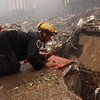 New York, NY, September 20, 2001 -- This rescue worker talks to a co-worker inside the pile of rubble at the World Trade Center.<br /> <br /> Photo by Andrea Booher/ FEMA News Photo