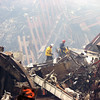 New York, NY, September 20, 2001 -- Rescue workers move through the wreckage with equipment that will help them cut free debris so that it can be safely removed.<br /> <br /> Photo by Mike Rieger/ FEMA News Photo