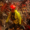 New York, NY, September 21, 2001 -- A rescue worker emerges from the pile of rubble at the World Trade Center. The clean up operation is expected to take months.<br /> <br /> Photo by Andrea Booher/ FEMA News Photo