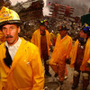 New York, NY, September 20, 2001 -- New York Fire Department workers show signs of fatigue after working long hours to clear rubble and search for survivors at the World Trade Center.<br /> <br /> Photo by Andrea Booher/ FEMA News Photo