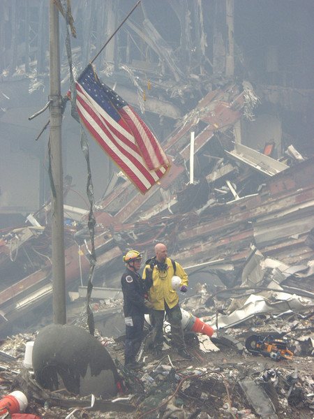New York, NY, September 20, 2001 -- Rescue workers standing next to the antenna that was formerly atop the World Trade Center discuss next steps in their rescue efforts.<br /> <br /> Photo by Mike Rieger/ FEMA News Photo