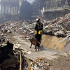 New York, NY, September 21, 2001 -- An Urban Search and Rescue crew member from Washington state searches through the rubble for survivors following the terrorist attacks on the World Trade Center.<br /> <br /> Photo by Michael Rieger/ FEMA News Photo
