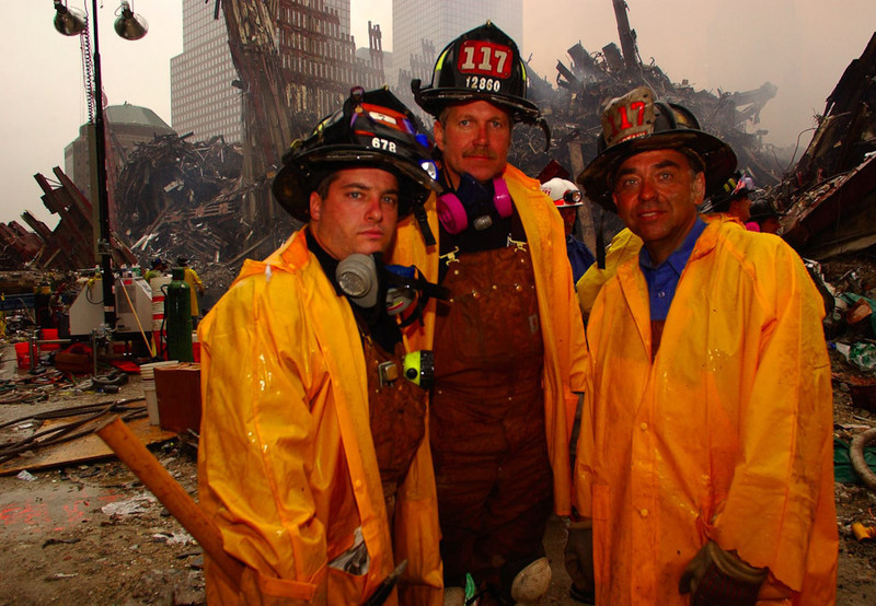 New York, NY, September 20, 2001 -- These New York Fire Department workers take a break from clearing rubble and searching for survivors at the World Trade Center.<br /> <br /> Photo by Andrea Booher/ FEMA News Photo