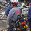 New York, NY, September 20, 2001 -- A rescue worker from a Miami, FL US & R team equiped with a searchcam prepares to enter the World Trade Center crash site.  The searchcam allows the workers to insert a small video camera into the wreckage to look for survivors.  Photo by Mike Rieger/ FEMA News Photo