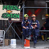 New York, NY, September 21, 2001 -- Two Urban Search and Rescue crew members take a break to eat and rest during the clean up operations at the World Trade Center.<br /> <br /> Photo by Michael Rieger/ FEMA News Photo