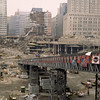 New York, NY, March 15, 2002 -- A Bailey bridge-turned-ramp descends into the Ground Zero crater, enabling personnel, machinery and materials to enter and leave the work area. The structure, spanning more than 500 feet, is a sectional-type bridge invented in 1940 and used in a variety of conditions.<br /> <br /> Photo by Larry Lerner/ FEMA News Photo