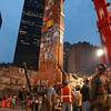 "020528-N-3783H-355<br /> New York City (May 28, 2002) -- Construction workers carefully maneuver the last piece of debris removed from ""Ground Zero"".  The event marked the final removal of the last remaining World Trade Center structure, Column Number 1001B of Two World Trade Center.  The 30-foot column remained standing following the collapse of the twin towers, when terrorists flew two commercial airliners into both skyscrapers on September 11, 2001.  The resulting collapse created a mountain of 1.8 million tons of steel and concrete. More than 3000 people perished in the attack.  U.S. Navy photo by Photographer's Mate 2nd Class Bob Houlihan.  (RELEASED)"
