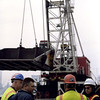 New York, NY, March 15, 2002 -- FEMA personnel discuss the World Trade Center debris removal operation in front of a 500-ton floating crane at the Pier 25 Loading Site, a few blocks from Ground Zero. Wreckage from the area is loaded into barges and towed to a Staten Island landfill. <br /> <br /> Photo by Larry Lerner/ FEMA News Photo