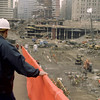 New York, NY, March 15, 2002 -- FEMA debris specialist Jim Leach looks down into the pit of the World Trade Center site from the ARCO bridge, which is used to allow heavy machinery to access the pit.<br /> <br /> Photo by Larry Lerner/ FEMA News Photo
