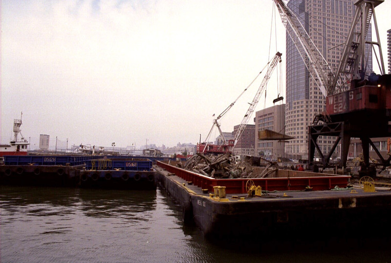 New York, NY, March 15, 2002 -- FEMA's debris removal operation includes the Pier 25 Loading Site, a few blocks from Ground Zero. Two 500-ton floating cranes place the wreckage into barges, which are towed to a Staten Island landfill. To date, more than 1.4 million tons of debris have been removed from the World Trade Center site.<br /> <br /> Photo by Larry Lerner/ FEMA News Photo
