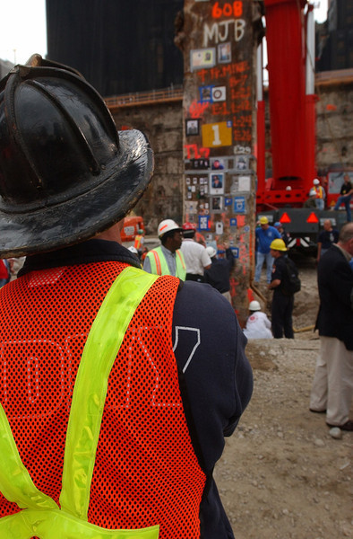 "020528-N-3783H-175<br /> New York City (May 28, 2002) – A New York City firefighter stands at ""Ground Zero"" as recovery efforts come to a close.  The event marked the final removal of the last remaining World Trade Center structure, Column Number 1001B of Two World Trade Center.  The 30-foot column remained standing following the collapse of the twin towers, when terrorists flew two commercial airliners into both skyscrapers on September 11, 2001.  The resulting collapse created a mountain of 1.8 million tons of steel and concrete. More than 3000 people perished in the attack.  U.S. Navy photo by Photographer's Mate 2nd Class Bob Houlihan.  (RELEASED)"
