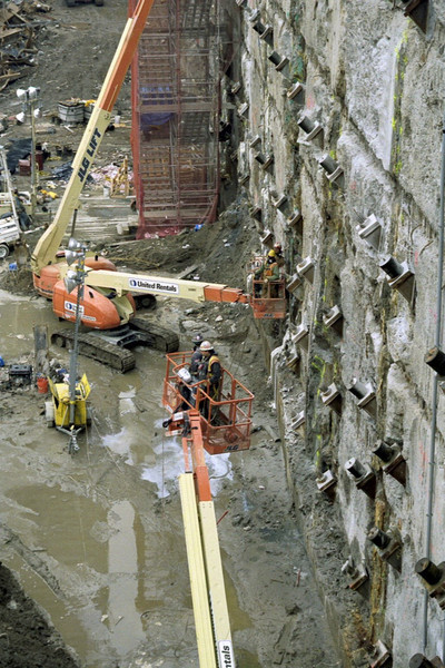 New York, NY, March 15, 2002 -- Personnel at Ground Zero tie back and reinforce the exposed slurry wall. The structure, which runs the perimeter of the crater, is monitored around the clock for movement and is holding up well. Its function is to counter the natural action of ground soil to push inward, into the hole where the World Trade Center complex once stood.<br /> <br /> Photo by Larry Lerner/ FEMA News Photo