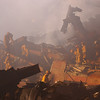 New York, NY, September 22, 2001 -- Firefighters continue to battle smouldering fires and search for survivors amongst the wreckage of the World Trade Center.<br /> <br /> Photo by Andrea Booher/ FEMA News Photo