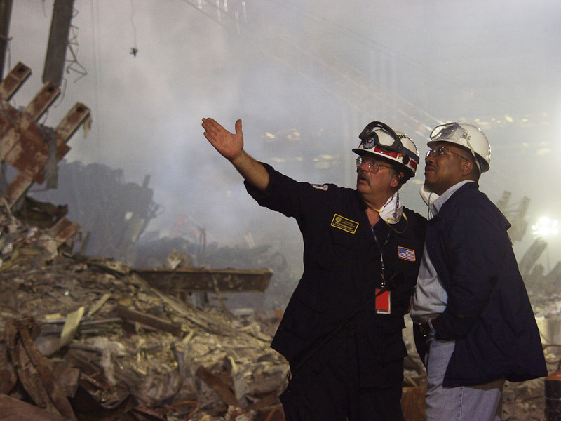 New York, NY, September 22, 2001 -- Colorado Lieutenant Governor Joe Rogers and FEMA Urban Search and Rescue team leader Pete Bakersky inspect the recovery operations underway at Ground Zero, the site of the World Trade Center collapse.<br /> <br /> Photo by Michael Rieger/ FEMA News Photo