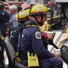 New York, NY, September 24, 2001 -- Members of the Florida Urban Search and Rescue Task Force-2 drive through the site of the recovery operation underway at the World Trade Center.<br /> <br /> Photo by Michael Rieger/ FEMA News Photo