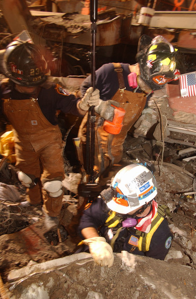 New York, NY, September 22, 2001 -- FEMA's Urban Search and Rescue teams search for survivors amongst the wreckage of the World Trade Center.<br /> <br /> Photo by Andrea Booher/ FEMA News Photo