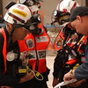New York, NY, September 28, 2001 -- Urban Search and Rescue team members review site maps at the World Trade Center.<br /> <br /> Photo by Andrea Booher/ FEMA News Photo