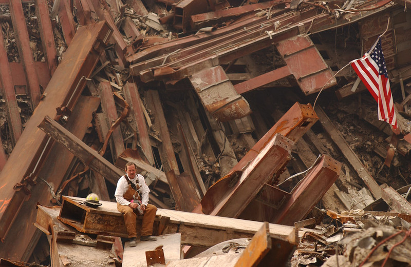 New York, NY, September 28, 2001 -- A firefighter sits amongst the wreckage of the World Trade Center.<br /> <br /> Photo by Andrea Booher/ FEMA News Photo
