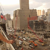 New York, NY, September 28, 2001 -- FEMA worker watches debris removal at the World Trade Center from nearby roof. <br /> <br /> Photo by Andrea Booher/ FEMA News Photo