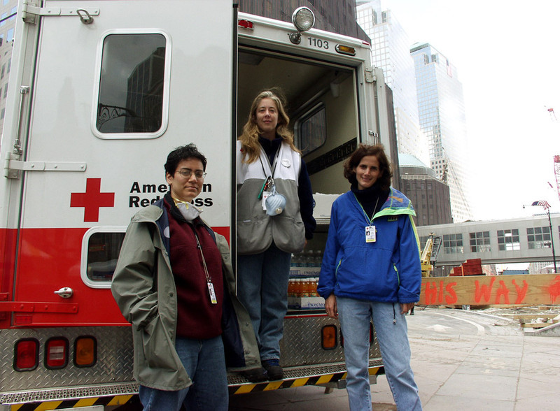 New York, NY, September 29, 2001 -- American Red Cross volunteers Christina DeGaray, Sara Jan Monahan and Alice Medalia take a break from providing relief to emergency workers at the World Trade Center.<br /> <br /> Photo by Michael Rieger/ FEMA News Photo
