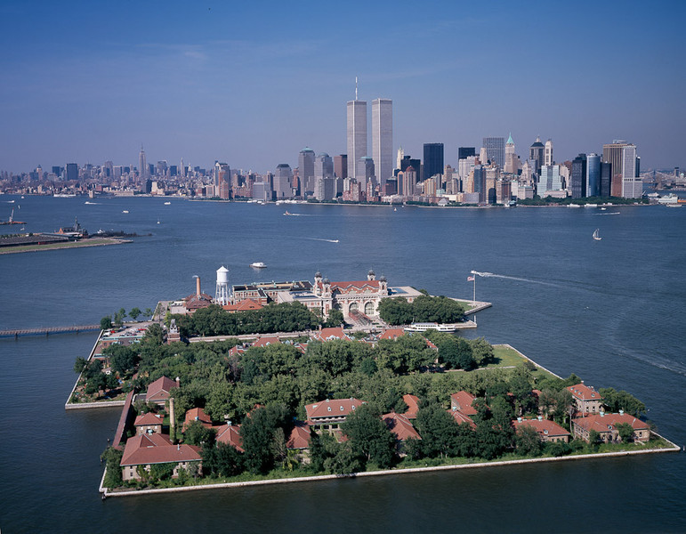 Aerial view of Ellis Island with New York City World Trade Center in the background taken in July 2001.