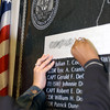 020911-N-4868G-054<br /> Pentagon, Arlington, Va., (Sep. 11, 2002) -- Family and friends of Navy personnel lost in the Sept. 11, 2001 attack on the Pentagon make pencil rubbings of the names of their lost loved ones.  The names are inscribed on a memorial dedicated on the first anniversary of the attacks.  The plaque is on permanent display near the newly reconstructed Navy Operations Center in the Pentagon.  U.S. Navy photo by Chief Photographer's Mate Philomena Gorenflo.  (RELEASED)