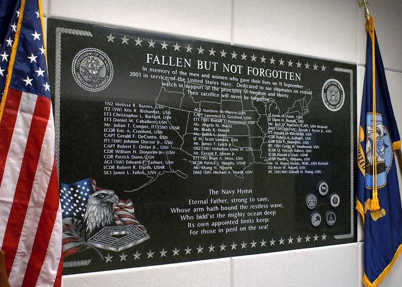 020911-N-4868G-001<br /> Pentagon, Arlington, Va., (Sep. 11, 2002) -- Unveiled during a dedication ceremony held on the first anniversary of the September 11th, 2001, terrorist attacks, a memorial wall located near the Navy's newly reconstructed Navy Operations Center, honors those Department of Navy personnel who perished when the hijacked American Airlines flight 77 crashed into the Pentagon.  U.S. Navy photo by Chief Photographer's Mate Philomena Gorenflo.  (RELEASED)