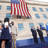 "020911-N-2383B-607<br /> Pentagon, Arlington, Va. (Sep. 11, 2002) – Local elementary school children watch as the Honorable George Bush (left), President of the United States and the Honorable Donald Rumsfeld, Secretary of Defense render honors at the unfurling of the National Ensign, and the playing of the National Anthem, during the Sept. 11th, 2002 Observance Ceremony.  More than 13,000 people attended the service to honor the 184 America's heroes who lost their lives one year ago when terrorists crashed a commercial airliner into the Department of Defense headquarters.  Elementary students, who lost classmates, and teachers aboard American Airlines Flight 77, recited the ""Pledge of Allegiance"" following the National Anthem.  The service was conducted on the southwest corner of the Pentagon where the attack took place, now known as the ""Phoenix"" reconstruction site.  U.S. Navy photo by Chief Photographer's Mate Johnny Bivera. (RELEASED)"