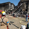010912-N-3235P-020<br /> Arlington, Va. (Sep. 12, 2001) -- A fire fighter from Arlington County, Fire Department surveys the scene during rescue and recovery efforts following the deadly Sep. 11 terrorist attack in which a hijacked commercial airliner was crashed into the Pentagon.  American Airlines FLT 77 was bound for Los Angeles from Washington Dulles with 58 passengers and 6 crew.  All aboard the aircraft were killed, along with 125 people in the Pentagon. U. S. Naval photo by Photographer's Mate 1st Class Michael W. Pendergrass.  (RELEASED)