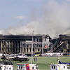 010911-N-3031B-001<br /> Arlington, Virginia (Sept. 11, 2001) -– Smoke and flames rise over the Pentagon at about 10 a.m. EST on Sep. 11, 2001, following a terrorist attack on the Pentagon in which terrorists hijacked a commercial airliner and crashed the plane into the side of the Pentagon.  Part of the building collapsed while firefighters continued to battle the flames and look for survivors.   The building was evacuated, as were the federal buildings in the Capitol area, including the White House.  American Airlines FLT 77 was bound for Los Angeles from Washington Dulles with 58 passengers and 6 crew.  All aboard the aircraft were killed, along with 125 people in the Pentagon. U.S. Navy Photo by Photographer's Mate 2nd Class Lisa Borges (RELEASED)