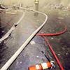 010912-N-3235P-026<br /> Arlington, Va. (Sep. 12, 2001) -- Hoses lay throughout the Pentagon structure during early efforts at fighting extensive fires after terrorists flew a commercial airliner into the building on Sep. 11, 2001.  American Airlines FLT 77 was bound for Los Angeles from Washington Dulles with 58 passengers and 6 crew.  All aboard the aircraft were killed, along with 125 people in the Pentagon. U.S. Navy photo by Michael W. Pendergrass. (RELEASED)